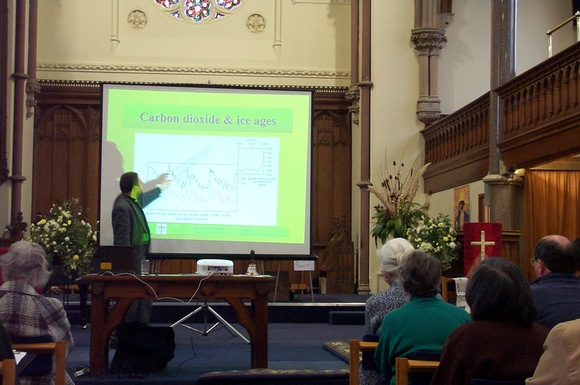 (Photograph: The Revd Professor Ian James explaining carbon dioxide and ice ages.)