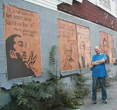 Scott Schaeffer-Duffy with his murals, Worcester