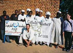 Chris Douçot and Grace Ritter in Sudan with African chiefs and Arab sheiks