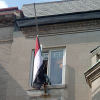 Embassy staffer lowers flag to half-mast