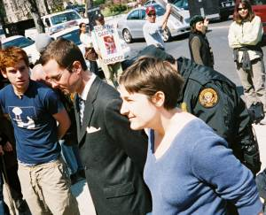 Philip Loomis, Mike Benedetti, and Brenna Cussen are arrested by the Secret Service