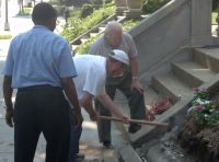 Smashing concrete with an axe
