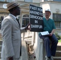 A well-dressed Sudanese man chats with Scott Schaeffer-Duffy